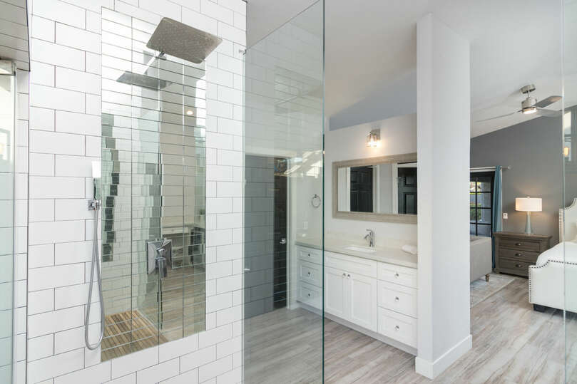 Incredible, indoor walk in shower with two shower head and an outdoor soaking tub.