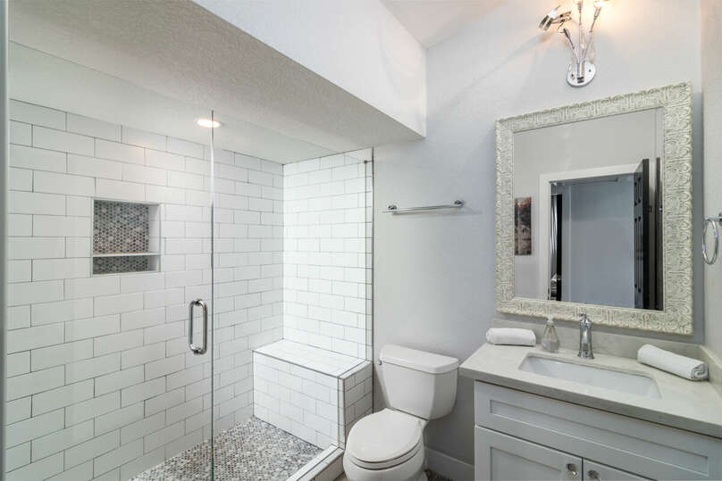 Second bathroom with large walk-in shower.