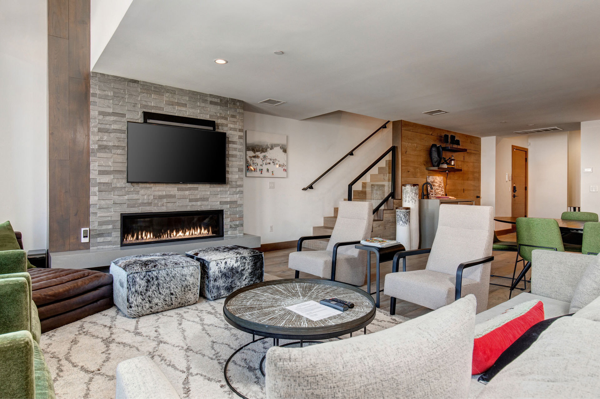Spacious Living Room with Professionally Decorated and Comfortable Furnishings, Gas Fireplace, a 55