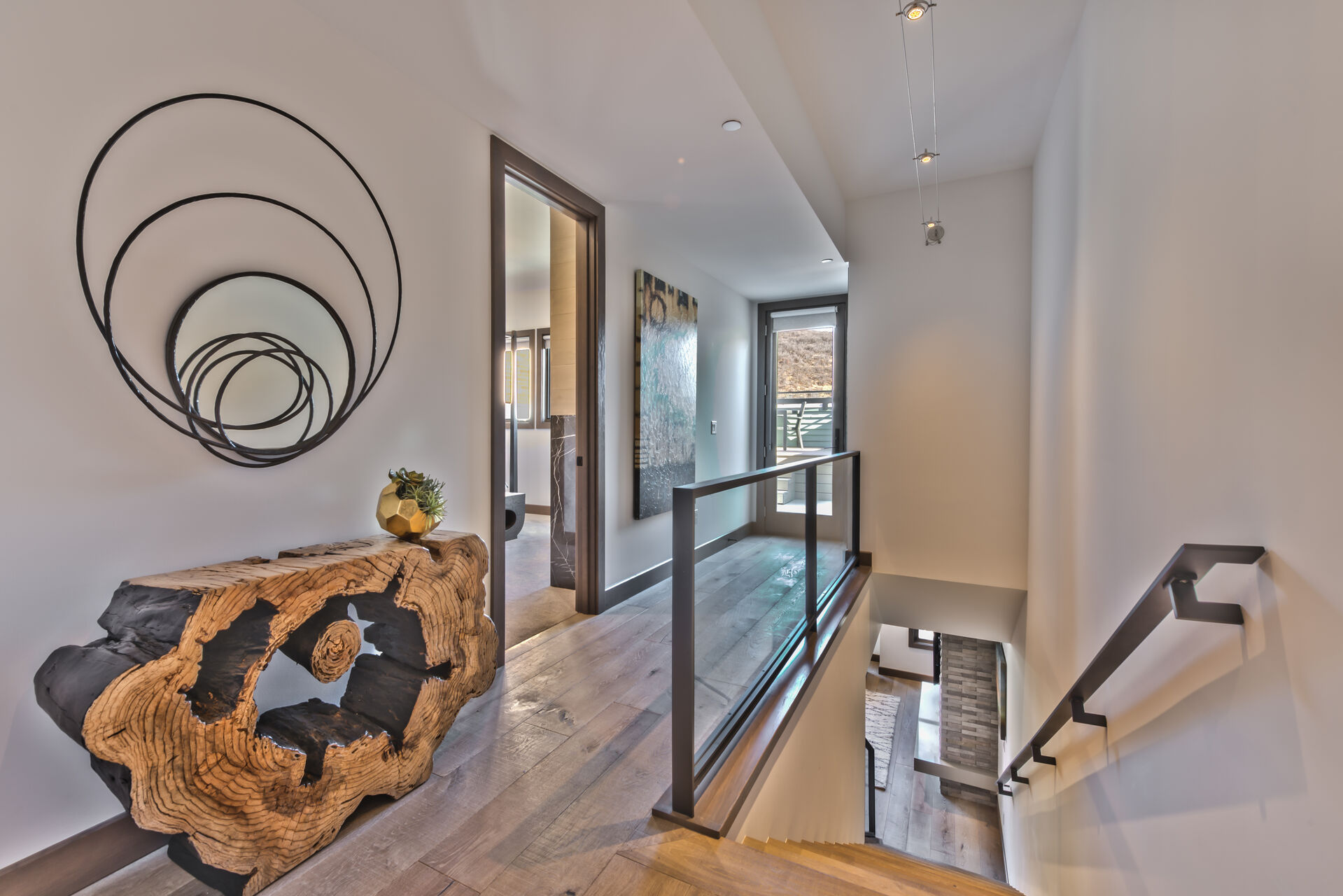 Main Level Stairs to Upper Level Bedrooms and Large Private Deck with Hot Tub Overlooking Main Street