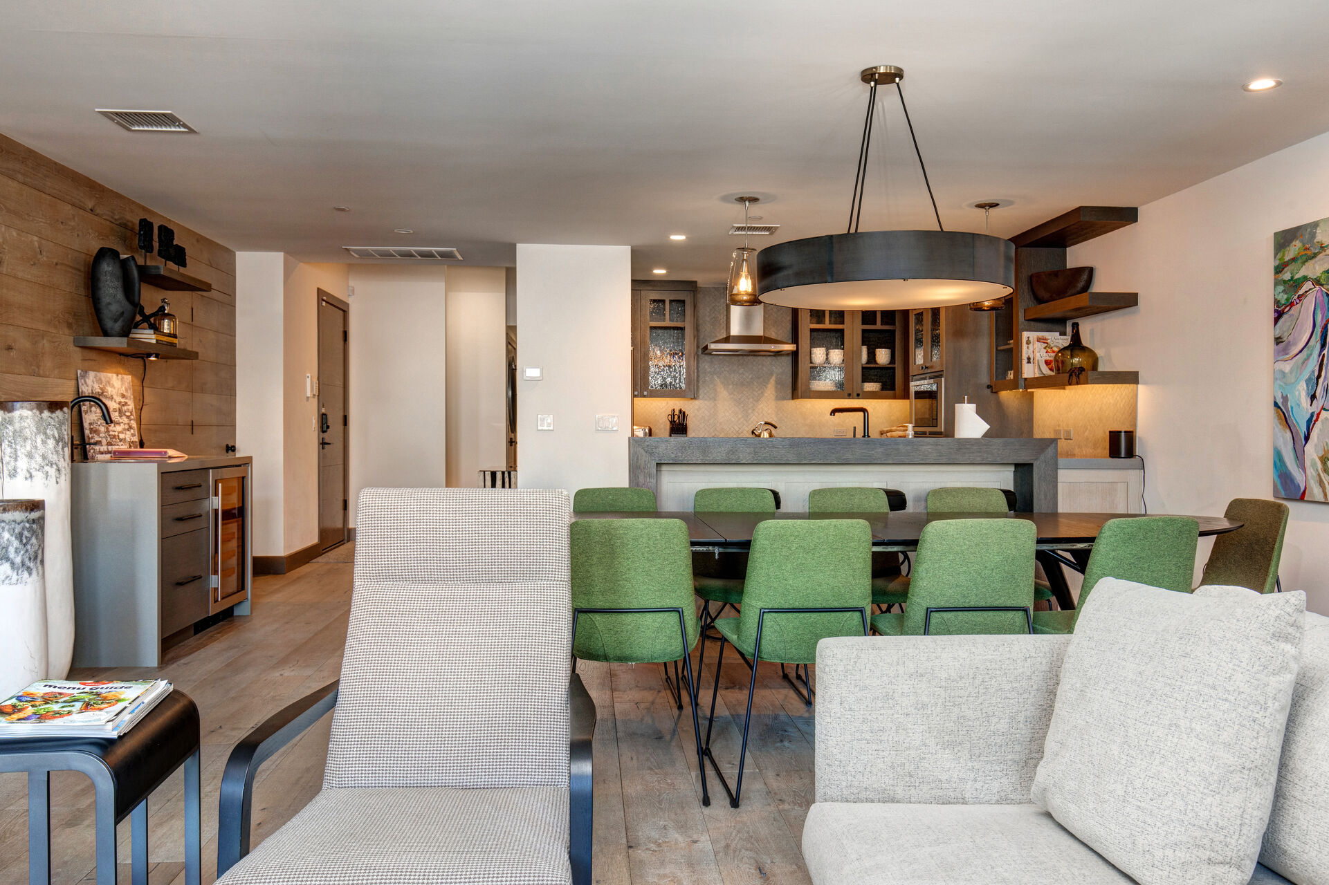 View of Dining Area, Kitchen Bar Seating and Wet Bar with Wine Fridge