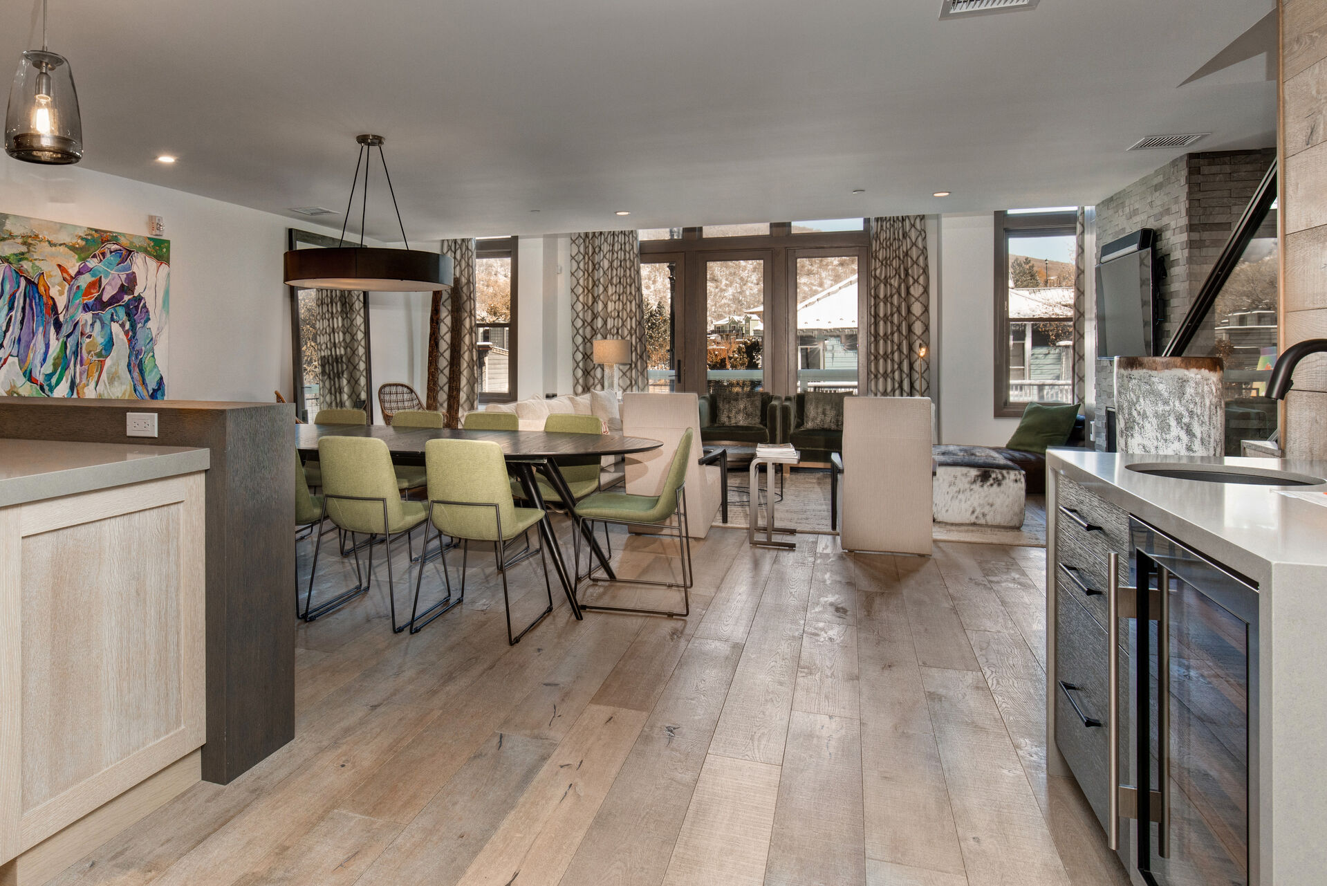Bar Seating for 3 and a Wet Bar with Two-Zone Wine Fridge