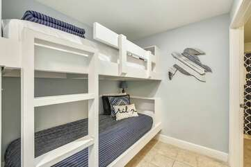 Nautical bunk area with two twin bunk beds