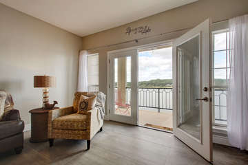 French doors open onto the expansive balcony to let in the breeze and the calming sound of the lake.