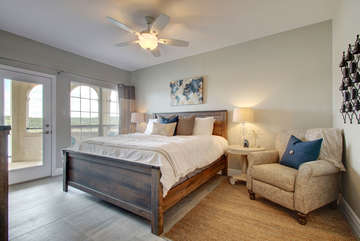 Crawl into this King-sized comfy bed & wake up to the water! Chair reclines!