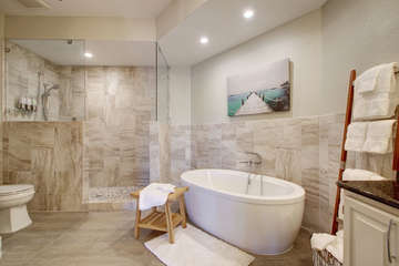 ahhhhh.... Relax after a long day on the Lake in this AMAZING special made to order tub! And look at that shower...