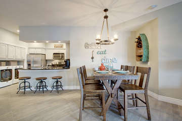 Dining table for 6, 3 barstools and a fully stocked kitchen- all with lake view!