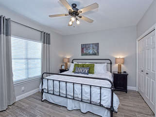 Perfection in the form of a guest room. Find comfort in this King bed room with a 55