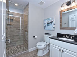 Guest bathroom accessible by hallway- shampoo, conditioner and body wash included!