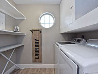 Laundry room in condo! You will also find tennis racquets and balls to enjoy a game of tennis.