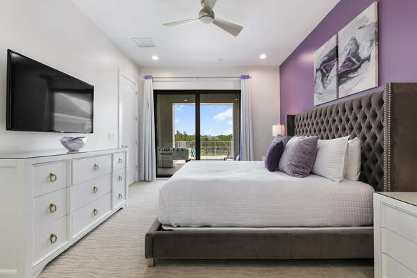 A second floor King sized bedroom with access to the main balcony