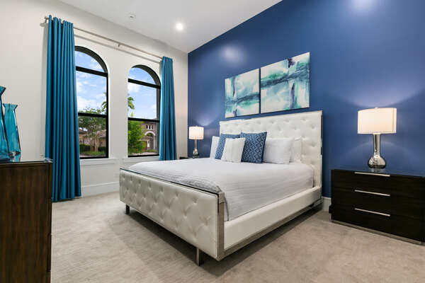 A main floor bedroom at the front of the villa with a King sized bed