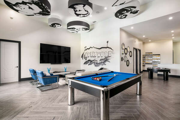 The room features a slate pool table and TV area to relax