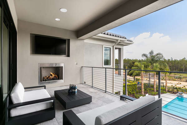 The loft features access to a balcony featuring comfortable outdoor furniture