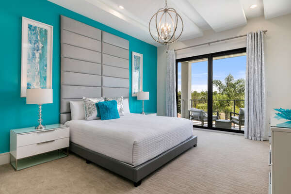 The second floor master bedroom has a private balcony overlooking the pool and golf course