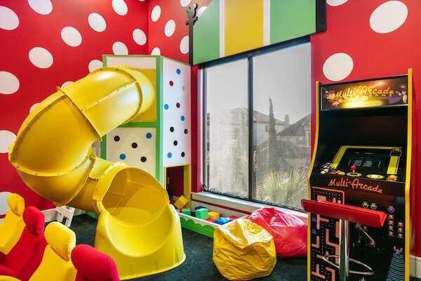 A fun spiral slide, foam pit, and arcade games await