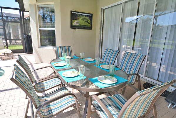 Patio table with outdoor TV