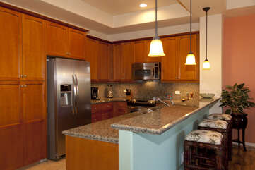 Kitchen with Breakfast Bar, Refrigerator, and Microwave