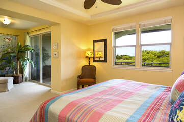 Large Bed, Ceiling Fan, and Chair, and Sliding Doors to the Balcony