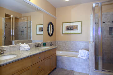 Bathroom with Double Sinks and Walk-in Shower