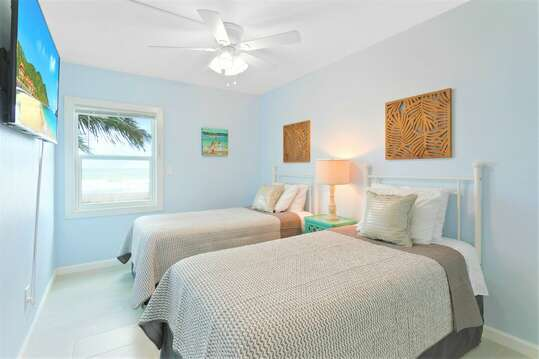 Guest bedroom #2: two twin beds, closet, Roku TV & view of the ocean!