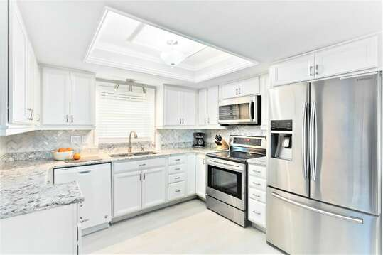 Make family meals in this gorgeous chefs kitchen with stainless steel appliances, granite counters & custom cabinets