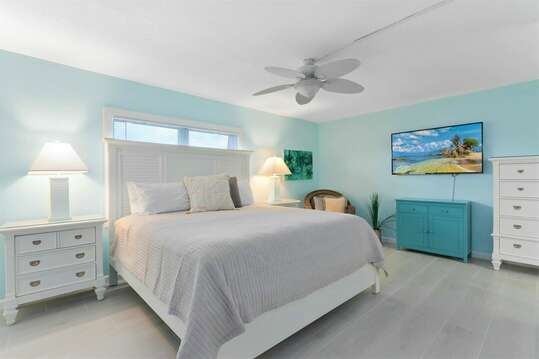 Spacious and calming master bedroom with an ensuite, closet, Roku TV