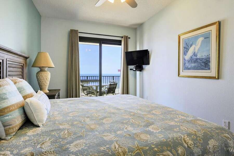Master Bedroom with King Size Bed and Private Balcony Access