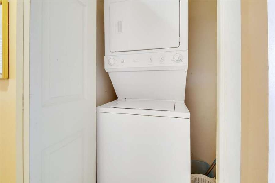 Laundry Closet has a Stacked Washer and Dryer