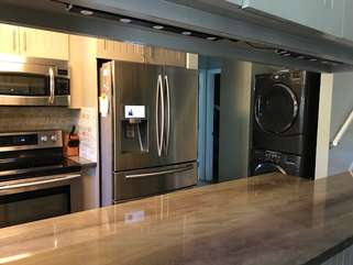 The newly remodeled kitchen is open to the great room.