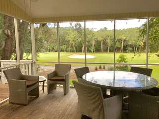 Gather around the large wicker table and watch the golfers play the 7th green of the Ocean Winds Golf Course.