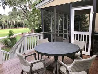 Relax and enjoy the outdoors while your favorite meal is cooking on the grill. Not pictured is a Kitchen Aide propane gas grill.