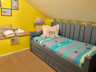 The private loft bedroom has a day bed with a trundle bed.