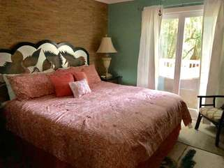 Master bedroom with a king bed.