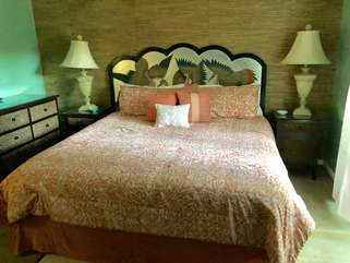 The master bedroom is on the first floor and has a king size bed.