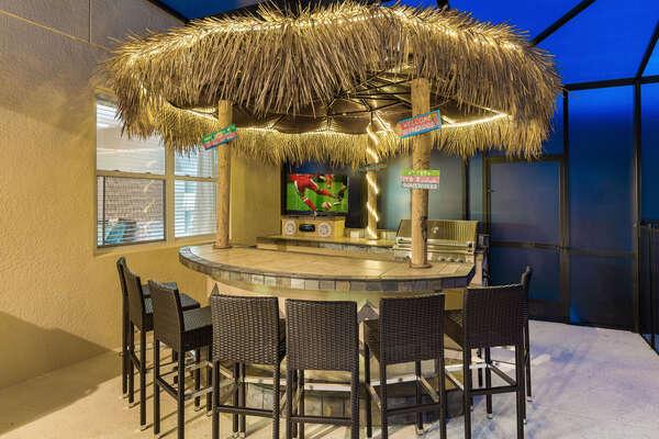 Amazing tiki bar with gas BBQ grill, TV & fridge.