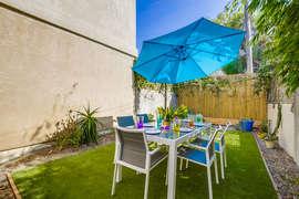 Side yard outdoor space near front door.