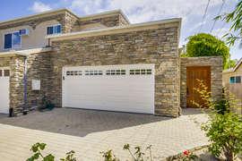 Garage and front entrance door to yard and front door.