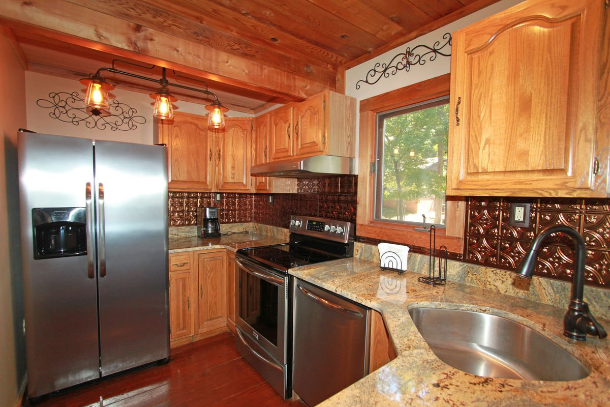 Kitchen with Dishwasher, Refrigerator, and Coffee Maker.