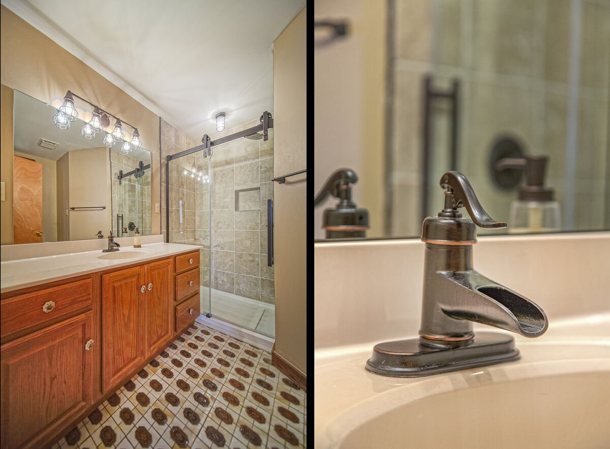 Bathroom with Single Vanity Sink, Mirror, and Shower.