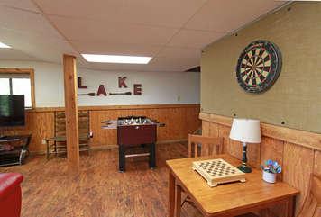 Foosball, TV, Darts, and Foosball Table.