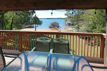 Outdoor Table and Chairs in the Deck with View of the Lake.
