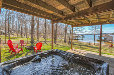 Hot Tub, Outdoor Chairs, and Fire Pit in the Backyard.