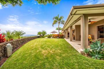 View of back Yard with Entrance to Ohana Room on the Right at Kona Hawaii Vacation Rentals