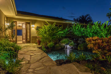 Front Entrance with Stone Path and Pond at Hale Akoa