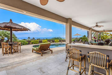 Covered Lanai with Plenty of Seating and Space for Entertainment