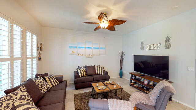 Large, Flat Screen TV & Comfortable Seating in the Living Area