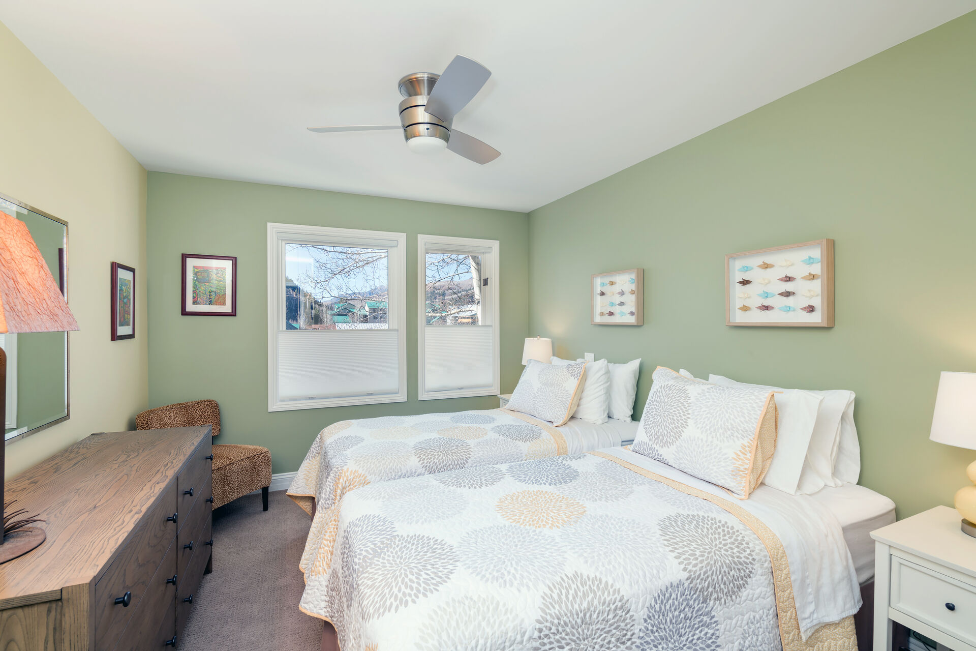 Bedroom with Two Beds, Dresser, Ceiling Fan, and Chair