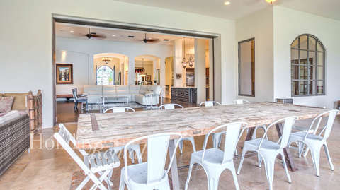 Outdoor dining area opens to the living room