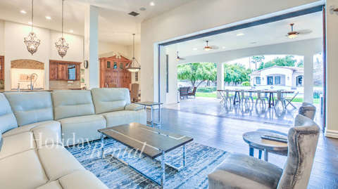 Views of the large kitchen, living room and outdoor seating